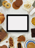 Making cookies with a digital tablet Royalty Free Stock Photos