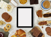 Making cookies with a digital tablet Stock Image