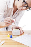 Making cosmetics. Young student preparing home made cosmetics Royalty Free Stock Photo