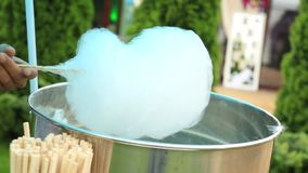 Making cotton candy or candy floss stock video