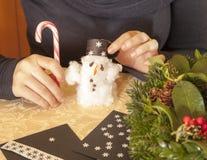Making cotton-wool snowman Royalty Free Stock Image
