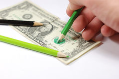 Making a counterfeit bill. Man drawing a counterfeit bill. Easy way to get money Royalty Free Stock Image