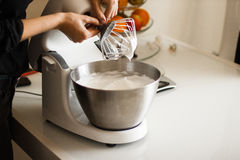 Making of a cream for home-made cakes on a mixer royalty free stock photos