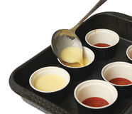 Making creme caramel. Stock Photo