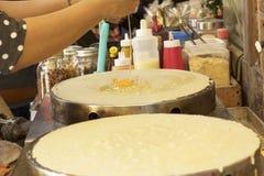 Making  crepe banana chocolate crispy pancake Royalty Free Stock Photography