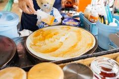 Making crepe pizza egg  tuna crispy pancake Royalty Free Stock Images