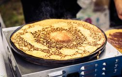 Making of crepes pancakes in open market festival fair. Royalty Free Stock Photos