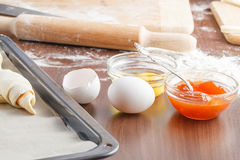 Making croissant on wood table Stock Photography