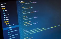 Making Css3 code on the blue background in the code editor. Closeup stock image