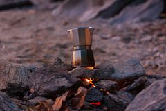 Making a cup of coffee on the beach. royalty free stock photo
