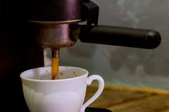 Making a coffee cup machine espresso . Process of preparation of coffee Royalty Free Stock Photography