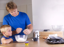 Making cupcakes Stock Images