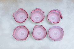 Making cupcakes at home. Paper shapes on flour background.  royalty free stock photo