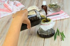 Making curative oil from herbs Stock Photo