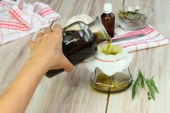 Making curative oil from herbs Stock Photos