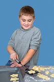 Making cutout cookies Stock Images