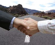 Making a deal !!. Making a deal on the road Royalty Free Stock Images