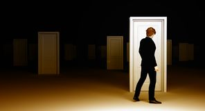 Man choosing a direction. Making a decision by choosing a door to open from as room full of identical door Royalty Free Stock Photography