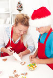 Making decorated christmas cookies Royalty Free Stock Photos