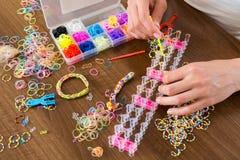Making decorative bracelet with elastic bands Royalty Free Stock Photos
