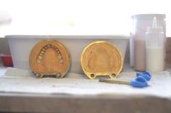 Making dental prosthesis. Making dentures in a dental lab Royalty Free Stock Photo