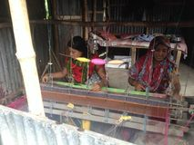 Making Dhakai Jadani Shari. There are many kinds of Shari.dhakai jamdani Shari is famous of the world.this Shari making two women,in Bangladesh Stock Photos