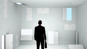 When making difficult decision. Businessman in room choosing one of plenty of doors Royalty Free Stock Photo