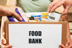 Making Donations To Food Bank. Poeple Making Donations To Food Bank royalty free stock images