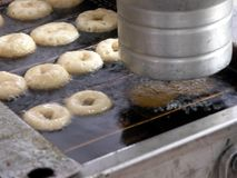 Making donuts. Donut making machine at a farmers market in Baltimore Royalty Free Stock Photo