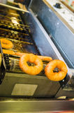 Making donuts. Details of the donuts making process Royalty Free Stock Photography