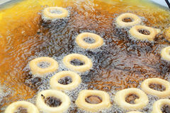 Making donuts fried in a pan.  Royalty Free Stock Images