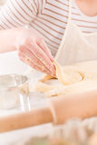 Making donuts Stock Images