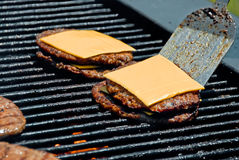 Making double cheese burgers royalty free stock photo