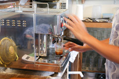 Making a double shot of espresso Stock Images