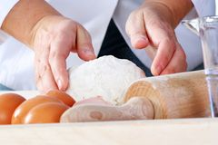 Making dough. For tasty baked goods, narrow focus royalty free stock photos