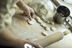 Making a dough. Photo of woman making a dough Royalty Free Stock Photos