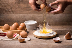 Making dough background. baking background with raw eggs, sugar, Royalty Free Stock Photography