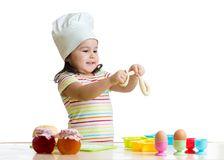 Making dough is fun. Little chid playing with Stock Images