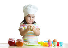 Making dough is fun. Little chid playing with Stock Photos