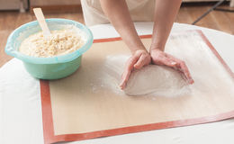 Making dough by hands at bakery. Making dough by female hands at bakery Royalty Free Stock Image