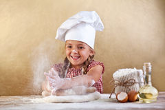 Making the dough for pizza is fun royalty free stock photos