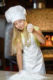 Making the dough for pizza is fun - little chef Royalty Free Stock Photos