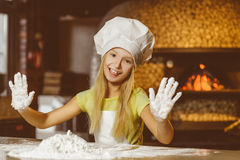 Making the dough for pizza is fun - little chef Stock Photography