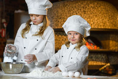 Making the dough for pizza is fun - little chefs Stock Photo