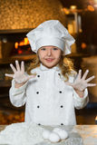 Making the dough for pizza is fun - little chefs Stock Photography