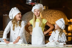 Making the dough for pizza is fun - little chefs Stock Photos