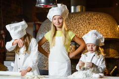 Making the dough for pizza is fun - little chefs Royalty Free Stock Image
