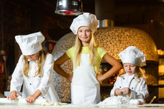 Making the dough for pizza is fun - little chefs Royalty Free Stock Photography