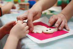 Making dough toy. Child and mother hands are making toy from dough royalty free stock photography