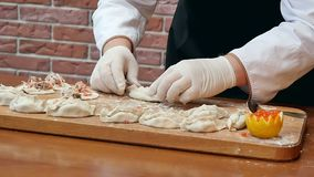 Making dumplings with seafood on wooden board. Close up. Slow motion. Professional shot in HD resolution. 084. You can use it e.g. in your commercial video stock video footage